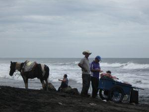 Salvadorian cowboy buys an ice cream on Playa el Tunco, photo by Aaron Smith.