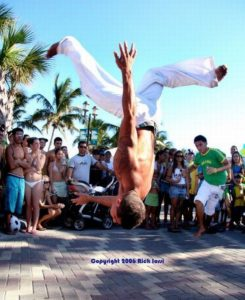 Capoeirista taking flight, photo by Rick Iossi/Flickr Creative Commons License.