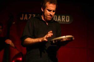 Scott Feiner performing on the pandeiro in New York City, photo by Ira Fox.