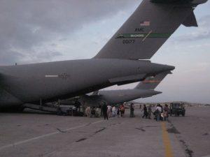 Boarding the cargo plane to be evacuated, photo by Edgar Daniel Zamundio/Haiti Earthquake DOS.