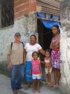 Lance Brown, winner of the 2010 raffle with family in Asa Branca, Rio de Janeiro, Brazil, News