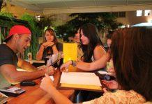 Gringo Café owner Sam Flowers tending bar at a past event, Rio de Janeiro, Brazil, News