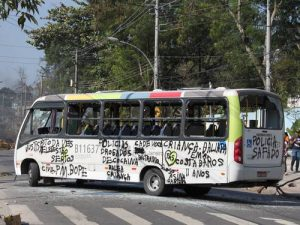 Graffiti on bus during protests following death of girl in Rio favela police operation, photo by O Globo reader Jucemir Ferreira.