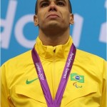 André Brasil at the podium receiving his first gold medal on August 30, photo by London 2012 official website