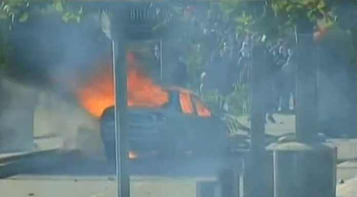 A TV Diário car was torched and at least 111 people arrested as violence erupted at a protest in Fortaleza, image recreation.