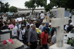 Crowd gathers to bury the five youths killed on Sunday morning by police officers, Rio de Janeiro, Brazil, Brazil News