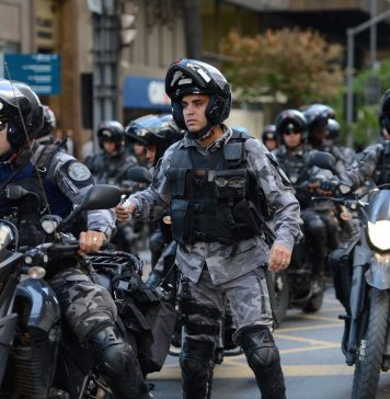 Brazil, Rio de Janeiro,Despite a few protests, military police officers continue to patrol Rio streets, say officials,