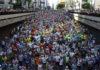 Brazil, São Paulo,Runners and spectators at the São Silvestre race in Avenida Paulista