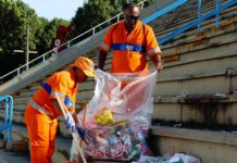 Brazil,Rio's Comlurb workers cleaning up city's sambodromo after samba school parade,