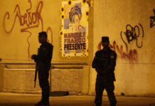 Brazil, Rio,Soldiers block off street fro the reconstruction of Marielle Franco's murder